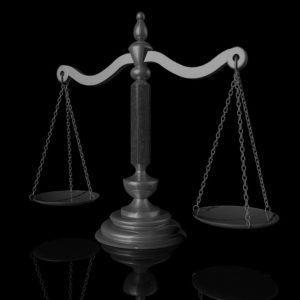 Immagine di una bilancia in bianco e nero, rappresentante il servizio delle indagini difensive offerte dall'azienda Verità Legale.